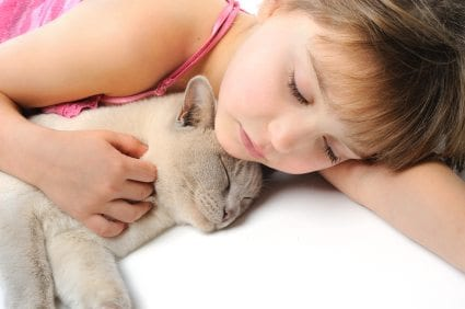 sleeping girl and her cat At What Age Should Your Child Have a Pet?